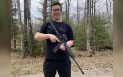 A photo of Rittenhouse, posing with an AR-15 style rifle, taken off of his Tik Tok before his account was removed.